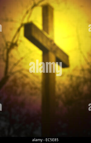 blurred wooden cross - Stock Image