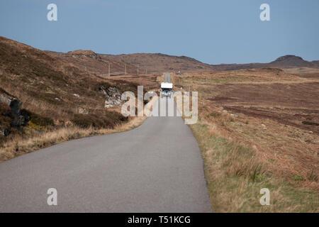 Campervan on single track road by Loch Ewe, Poolewe, west coast of Scotland. - Stock Image