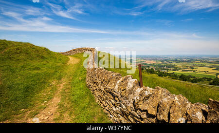 A Cotswold Stone wall and a view of Pershore and the Worcestershire Countryside, England - Stock Image