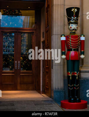 Edinburgh, Scotland, United Kingdom, 8th November 2018. Christmas celebrations: A giant nutcracker soldier stands guard outside the entranvcce of The Grand hotel in South St Andrew Square Street - Stock Image