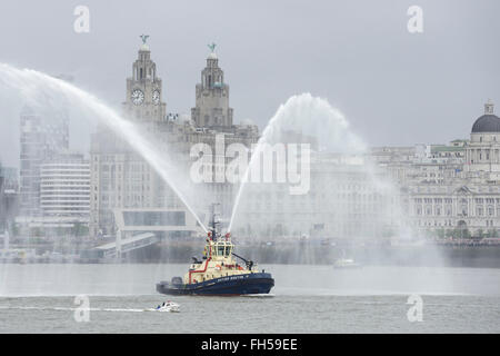 A fire boat in front of the Liver Building Liverpool UK - Stock Image