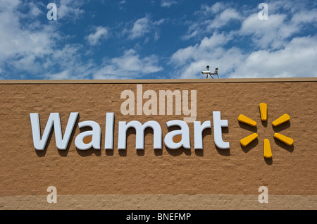 Signboard and logo of Walmart retail chain - Stock Image