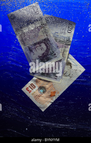 Pound Notes sinking in Water - Stock Image