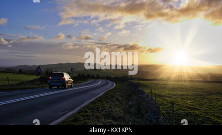 Peak District National Park, Derbyshire. 6th January, 2018. UK Weather: spectacular sunset along the A515 road between - Stock Image