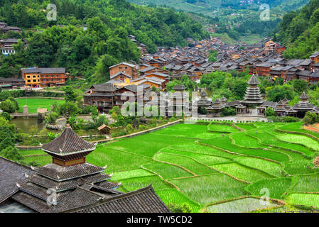 Dong village and rice paddy in the mountain, Zhaoxing, Guizhou Province, China - Stock Image