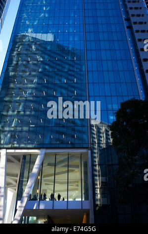 Silhouetted business men in city building, Brisbane QLD Australia - Stock Image