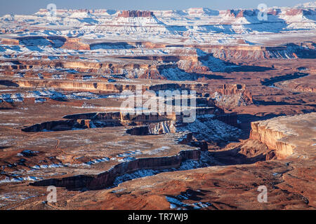 Buttes, mesas and canyons covered in snow, Green River Overlook. Island in the Sky District, Canyonlands National Park, Utah USA - Stock Image