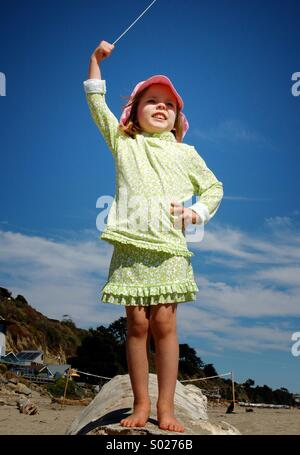 A little girl conducts her imaginary orchestra. - Stock Image