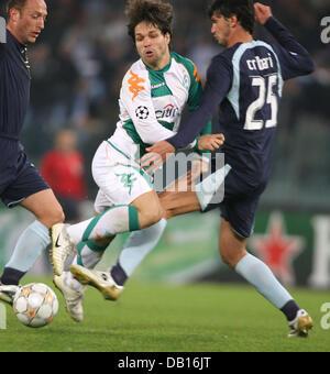 Werder Bremen's Diego (C), Emilson Sanchez Cribari (L) and Massimo Mutarelli of Lazio Rome vie for the ball - Stock Image