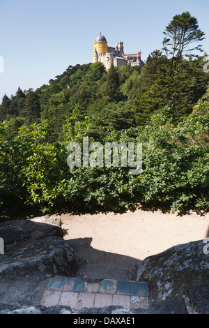 Sintra Gardens, Pena palace Portugal in the foreground a seat is cut in the rocks for Queen Mary of Portugal to - Stock Image