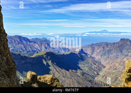 Gran Canaria island mountains landscape, view from peak Roque Nublo to Mount Teide on Tenerife island - Stock Image