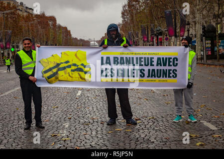 Paris, France. 1st December, 2018. Protesters holding a banner with 'Suburb with Yellow Vest' during the Yellow Vests protest against Macron politic. Credit: Guillaume Louyot/Alamy Live News - Stock Image