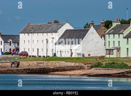 Telford House (centre right) in harbour street Portmahomack Tain Easter Ross Highland Scotland - Stock Image