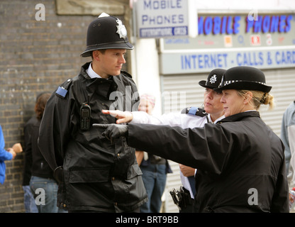 A Police Man and Two Police Women at the Notting Hill Carnival 2010 - Stock Image
