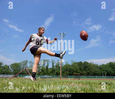 Sabrina Fronte, a freshman at North Haven High School, practices field goals as the team readies for their annual - Stock Image