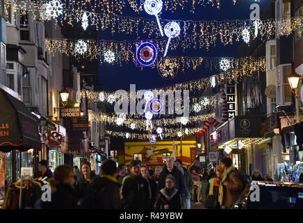 Brighton UK 26th November 2018 - Shoppers out in force in the North Laine district of Brighton late this afternoon as Christmas shopping gets in full swing amongst the lights Credit: Simon Dack/Alamy Live News - Stock Image