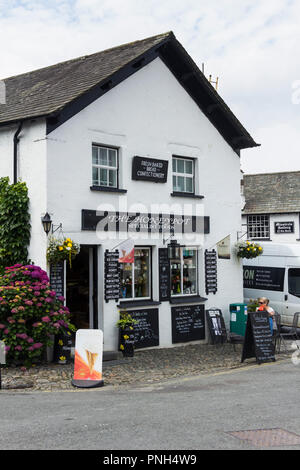 The Honeypot is specialist foods shop in Hawkshead, Cumbria. The shop sources from small local producers of honey,  preserves, chutneys, cooked meats - Stock Image