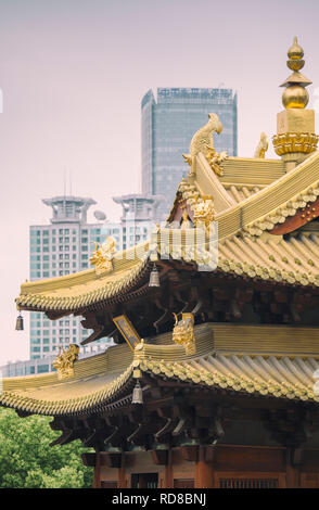 Jing'an Temple in Shanghai, China, with modern office buildings in the background - Stock Image
