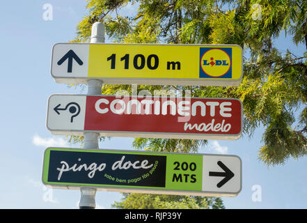 Road Sign Directions To The Popular Supermarket Stores In Albufeira Algarve Portugal - Stock Image