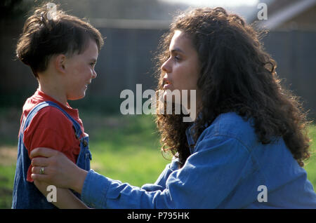 Anglo-Israeli mother talking to her young son outside - Stock Image