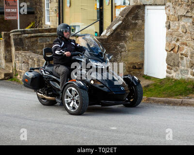 Man riding a Can-Am Spyder SD Limited Motor Tricycle in North Yorkshire England UK - Stock Image