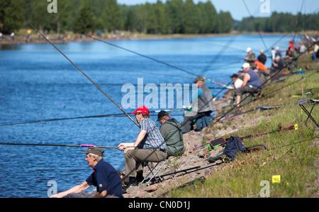 Veteran series competitors at Finnish national championships of angling 2011 at Kansola Saimaa Canal.  , Finland - Stock Image