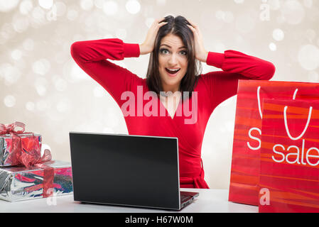 Santa Women in office with sale bag and laptop - Stock Image