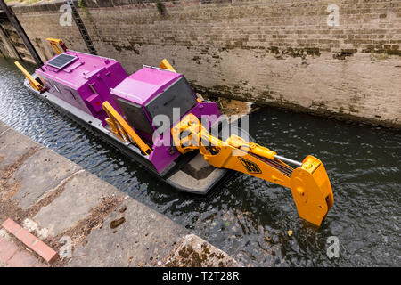Specially adopted JCB digger in Stroudwater Navigation canal, Stroud, Gloucestershire, UK - Stock Image
