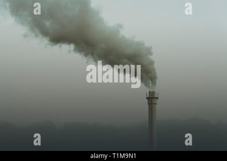 Smokestack emitting smoke, Neukoelln, Berlin, Germany - Stock Image
