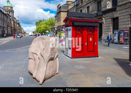 Baby Elephant, a sculpture by Ronald Rae, and a former Police Box on the corner of Hope Street and Princes Street, Edinburgh, Scotland, UK. - Stock Image
