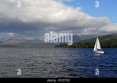 A small yacht on Lake Windermere,Lake District National park,Cumbria,England,UK - Stock Image