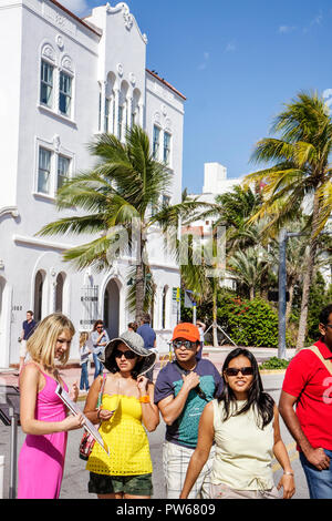 Miami Beach Florida Ocean Drive New Year's Day Art Deco District sidewalk cafe alfresco al fresco Asian couple man woman hats - Stock Image