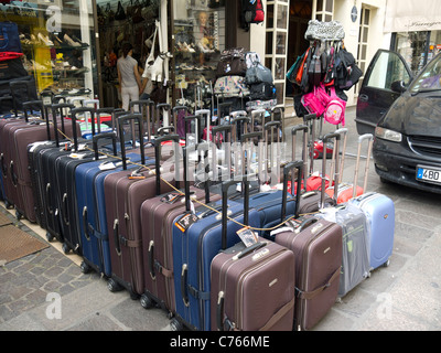 Rows of suitcases for sale in Paris, France - Stock Image