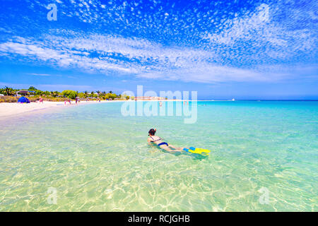 Woman snorkeling in the clear waters of Coral Bay on the Ningaloo coast. Western Australia - Stock Image