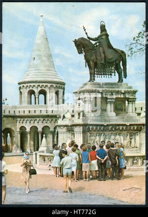 A postcard printed in Hungary, shows a view on the Fisherman's Bastion and St.Stephen Statue by sculptor Alajas - Stock Image
