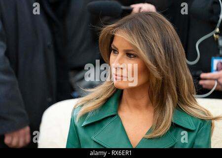 U.S First Lady Melania Trump, wearing a green leather double-breasted coat dress during a bilateral meeting between President Donald Trump and Czech Prime Minister Andrej Babis in the Oval Office of the White House March 7, 2019 in Washington, DC. - Stock Image