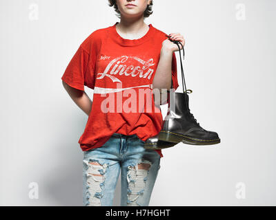 teen girl with boots and ripped jeans - Stock Image