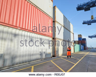 Dock worker with digital tablet - Stock Image