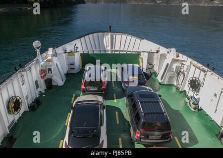 Norway, July 26, 2018: Loaded ferry en route. - Stock Image