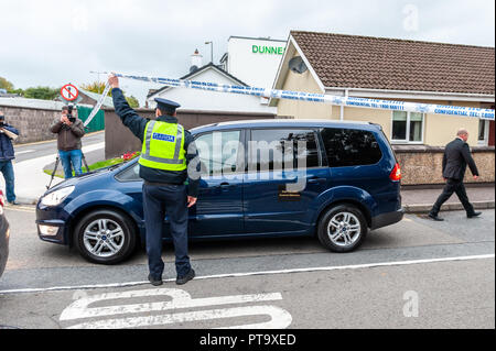 Macroom, West Cork, Ireland. 8th Oct, 2018. Local undertakers arrive to take away the body of the murder victim who was fatally stabbed in the early hours of this morning.  The murder victim has been named locally as 44 year old Timmy Foley. Credit: Andy Gibson/Alamy Live News. - Stock Image