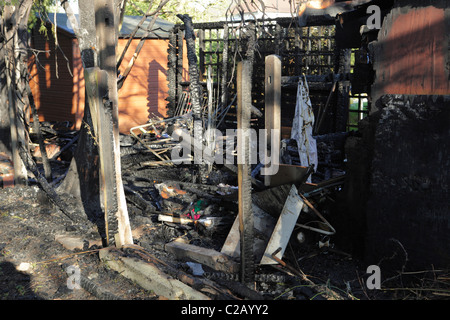 Suburban shed destroyed by fire - Stock Image