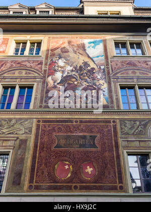 Mural on the town hall of Schwyz, Switzerland, of the battle of Morgarten (1315) between the Swiss confederates - Stock Image