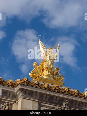 Airplane and Statue of Opera Garnier in Paris - Stock Image