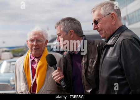 Tiff Needell interviewing  mini racing legends John Rhodes and  Steve Neal, in the International Paddock,  during the Silverstone Classic Media Day 2019 - Stock Image