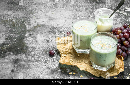 Fresh grape smoothie. On rustic background - Stock Image