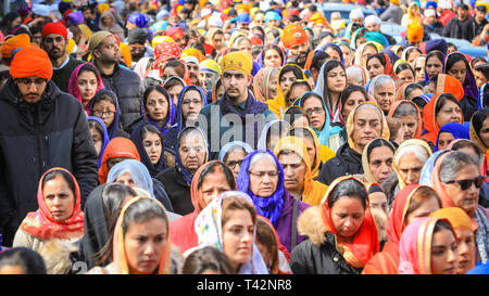 Gravesend, Kent, UK, 13th April 2019. Thousands of spectators and religious visitors line the streets of Gravesend in Kent to watch and participate in the annual Vaisakhi procession. Vaisakhi is celebrated by the Sikh community all over the world. Credit: Imageplotter/Alamy Live News - Stock Image