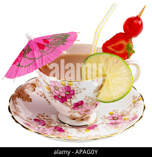 A teacup with the accoutrement's of a cocktail - Stock Image