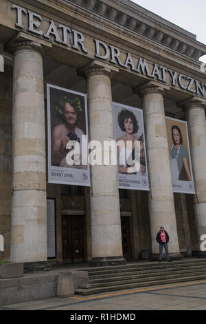 Warsaw, Poland, 11 November 2018: celebrations of Polish Independence Day. Man with Polish colors scarf in front of Drama Theater building in Warsaw - Stock Image