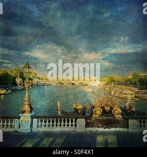 View of the Seine River from Pont Alexandre III, regarded as the most ornate, extravagant bridge in Paris. French - Stock Image