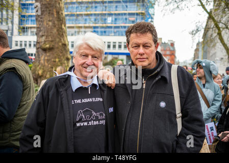 Stanley Johnson and Will Travers director writer, broadcaster and animal rights activist at a stop trophy hunting and ivory trade protest rally London - Stock Image